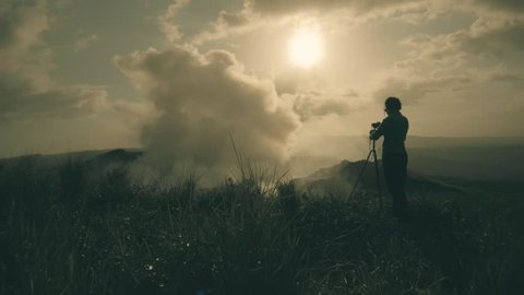Female photographer on the top pf the mountain near the Masaya Volcano National Park, Nicaragua. 4k
