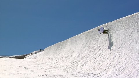 Free skier performs aerial in half pipe in slow motion, Park City, Utah.