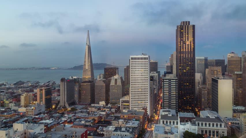 San Francisco skyline and city lights timelapse during sunset, California, USA