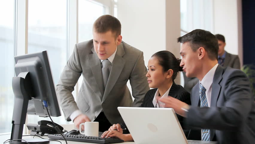 Businesspeople looking at monitor of computer and talking  | Shutterstock HD Video #1063912