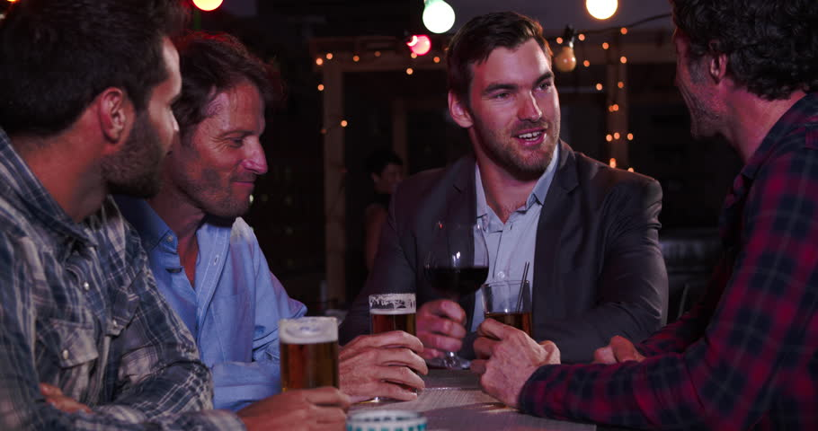 Group Of Male Friends Relaxing Together At Rooftop Bar | Shutterstock HD Video #10689209