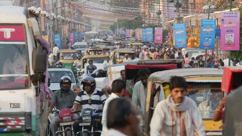 JAIPUR, INDIA - 21 OCTOBER 2014: Street scene in Jaipur, traffic makes its way through a busy street.