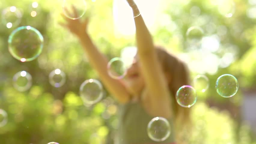 Happy Little Girl Playing wit Soap Bubbles outdoor, Laughing and Jumping. HD 1080p. Slow motion 240 fps, high speed camera
