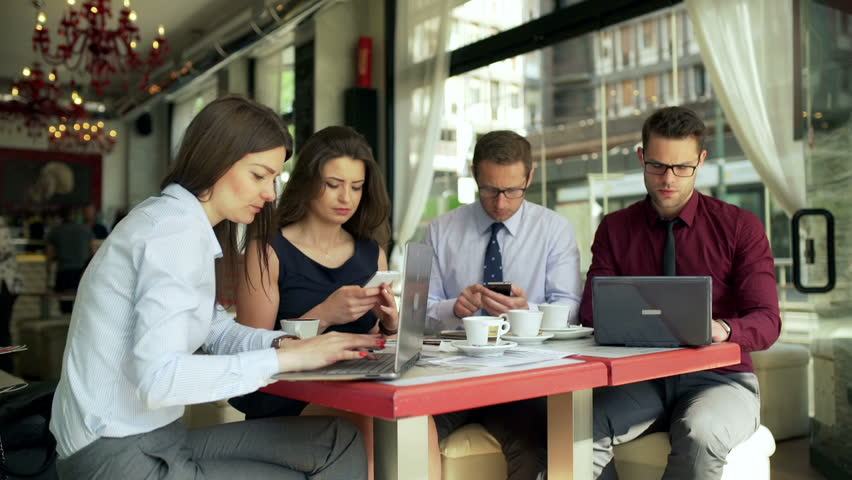 Busy businesspeople sitting in the cafe and working  | Shutterstock HD Video #10729502