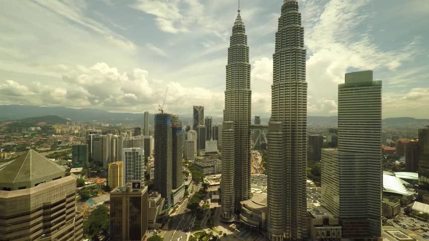 Kuala Lumpur, Malaysia, November 2014 - Aerial view of KL City, Petronas Twin Tower. Camera angle hovering from bottom to top. 1080p Resolution. Kuala Lumpur, Malaysia