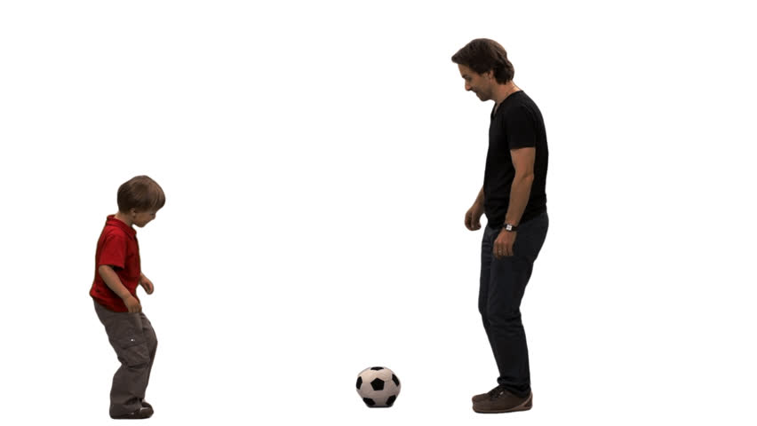 A little boy and his father playing football. Side view. Full HD footage (on alpha matte)