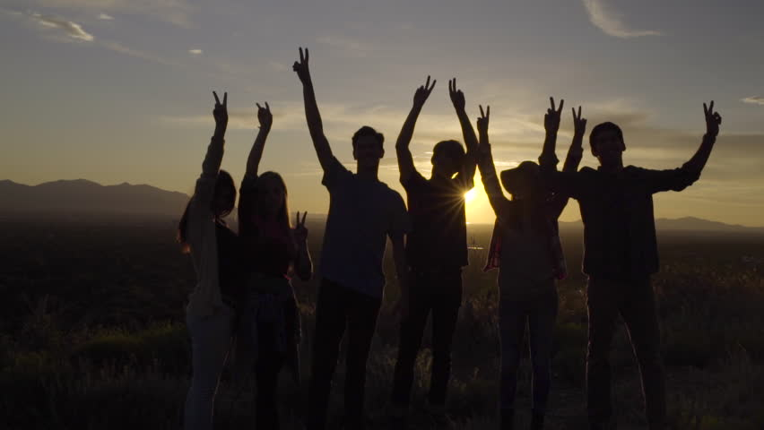 Group Of Teens Hold Up Peace Signs At Sunset Then Walk Away (Slow Motion) | Shutterstock HD Video #10773662