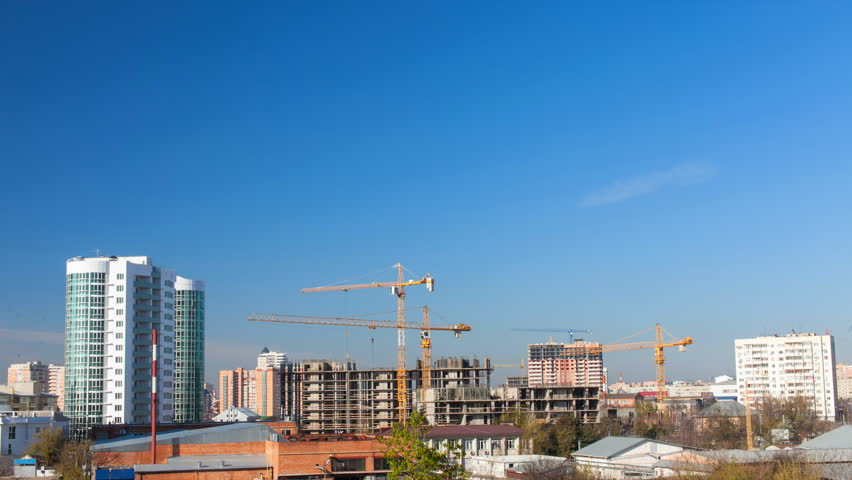 Time-lapse operation of tower cranes on construction of the building on a background of varied weather and the sky at different  times of the day | Shutterstock HD Video #10782797