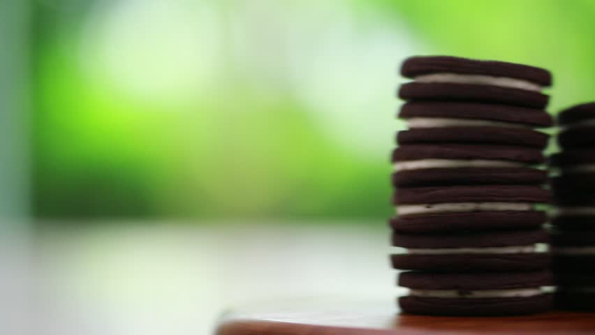 Stack of chocolate cream cookies, dolly shot   Shutterstock HD Video #10823612