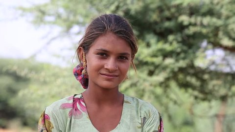 PUSHKAR, INDIA - OCTOBER 27, 2014: Unidentified girl at the the annual Pushkar Camel Mela. This fair is the largest camel trading fair in the world.