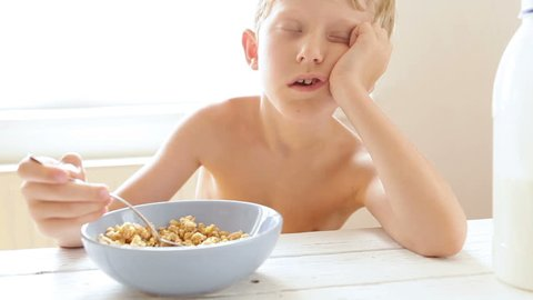 Sleeping boy forgot to add milk in his morning muesli