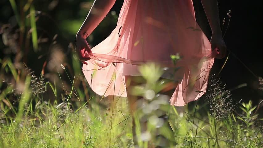 Girl Wearing Light Summer Dress Walking in the Field on Sunny Day Outdoors | Shutterstock HD Video #10958423