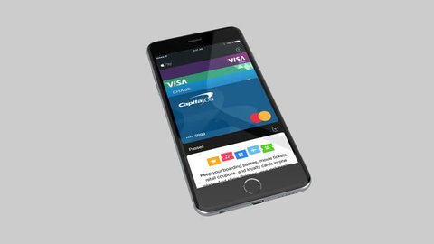FLINT CENTER, CUPERTINO, UNITED STATES - CIRCA JULY, 2015:  Apple Pay conceptual payment process with iPhone 6. Apple Pay is a mobile digital wallet service by Apple Inc.