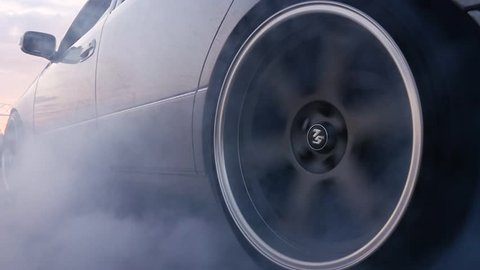 MOSCOW, CIRCA 2015: Close up rotating wheel of the sport car in slow motion. Slip slowmo