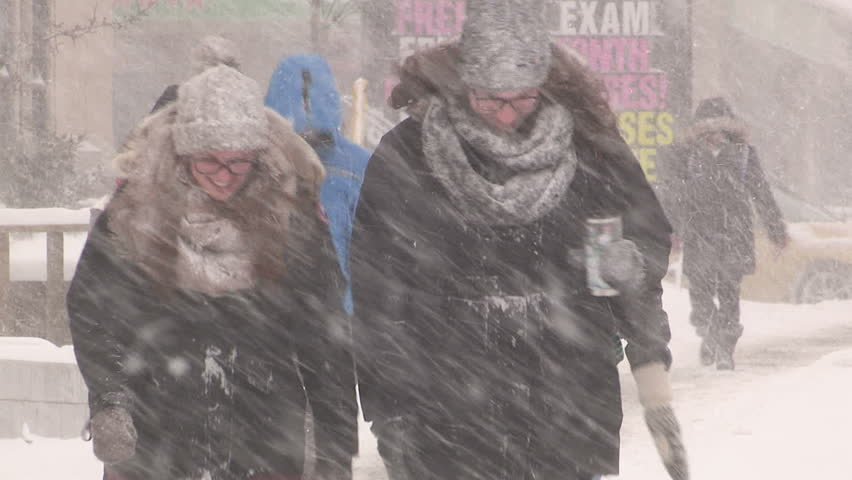 Waterloo, Ontario Canada January 2014 Diverse people walking in blizzard snow wind  cold weather in major winter storm