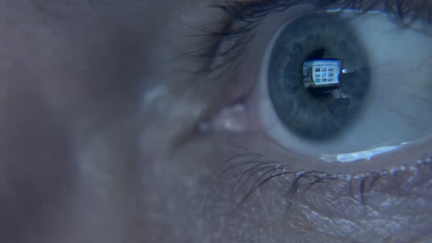 Closeup shot of man's  eye surfing internet at night | Shutterstock HD Video #11078762