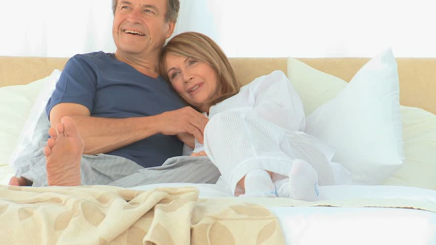 Lovely couple watching tv on their bed   HD stock video clip. Romantic Husband Bringing His Happy Wife Breakfast In Bed At Home