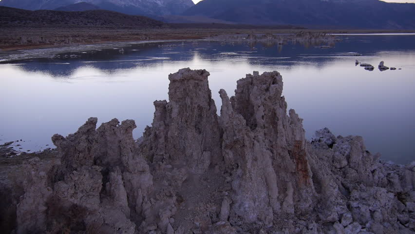 AERIAL: Flying around big tufas formation in beautiful sunset in Mono Lake