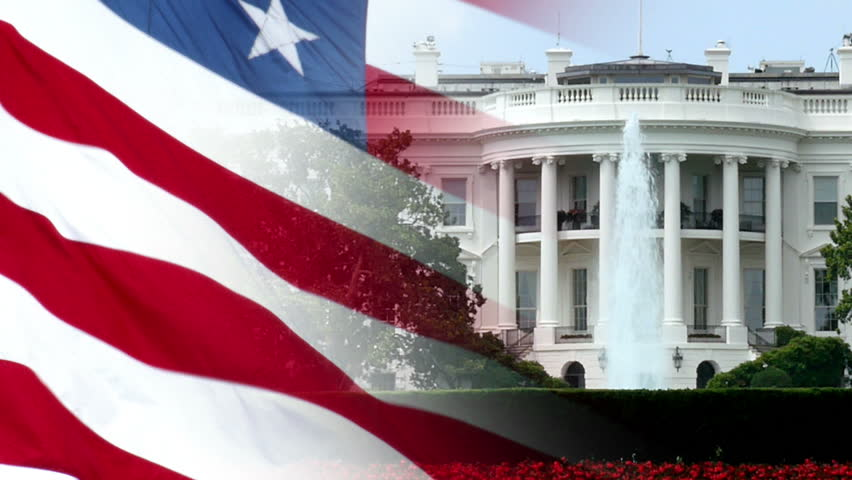 A patriotic background of a slow motion American flag composited over a shot of the White House.