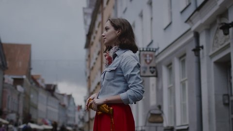 Girl is Opening Umbrella at Rainy Day. Shot on RED Cinema Camera in 4K (UHD).