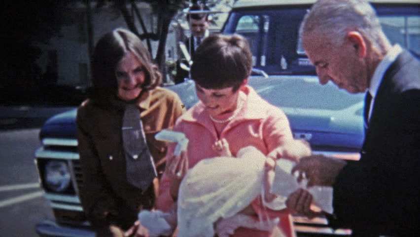 GREENSBORO, NC -1969: Young mother has baby ready for baptism christening.