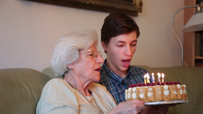 Stock Video Clip of Grandmother grandson blowing birthday candles
