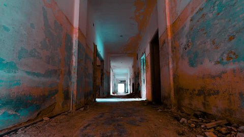 4K linear tracking inside a scary abandoned coridor of an evacuated building.Linear motion control timelapse inside a long hallway of a long-ago abandoned and evacuated building.