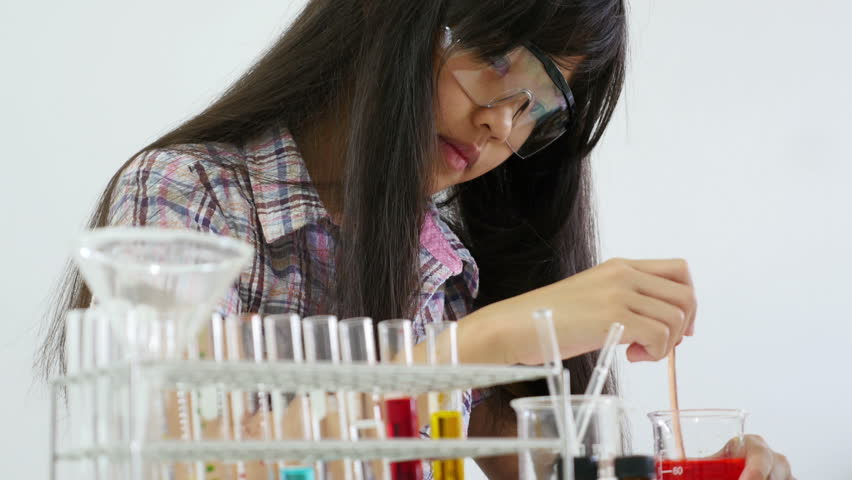 Little Asian student girl making science experiments. Education. | Shutterstock HD Video #11251232