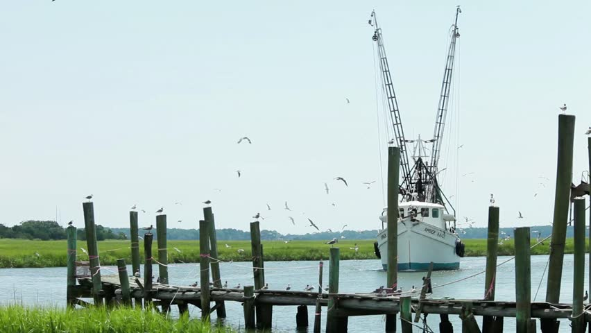 BEAUFORT, SOUTH CAROLINA-AUGUST 19, 2015: A commercial fishing vessel comes in to dock after fishing for shrimp near Beaufort, South Carolina