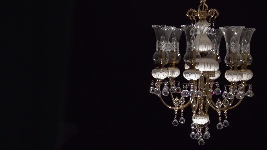 Crystal Chandelier On Black Background. Crystals Sway And Sparkle ...