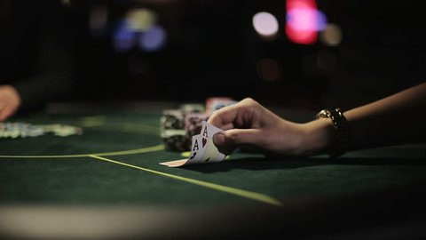 Poker player shows his good pair hand for win two aces and doing all-in