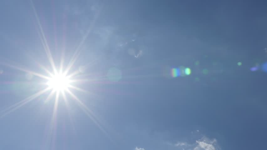 Sun shine and blue sky with smoky clouds passing 4K 2160p 30fps UltraHD footage - Sun flares and blue sky with clouds passing 4K 3840X2160 UHD video