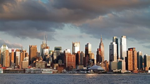 NEW YORK - AUGUST 27, 2012: Manhattan Island Skyline transitioning from day to night, timelapse of skyscrapers over 24 hours in NY. Manhattan is a borough in New York City.