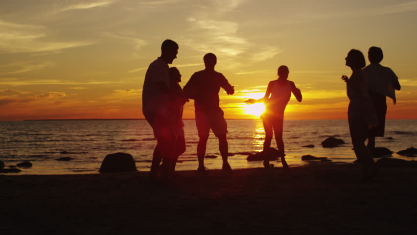 Four Friends Jumping On The Beach At Sunset Silhouetted -6353