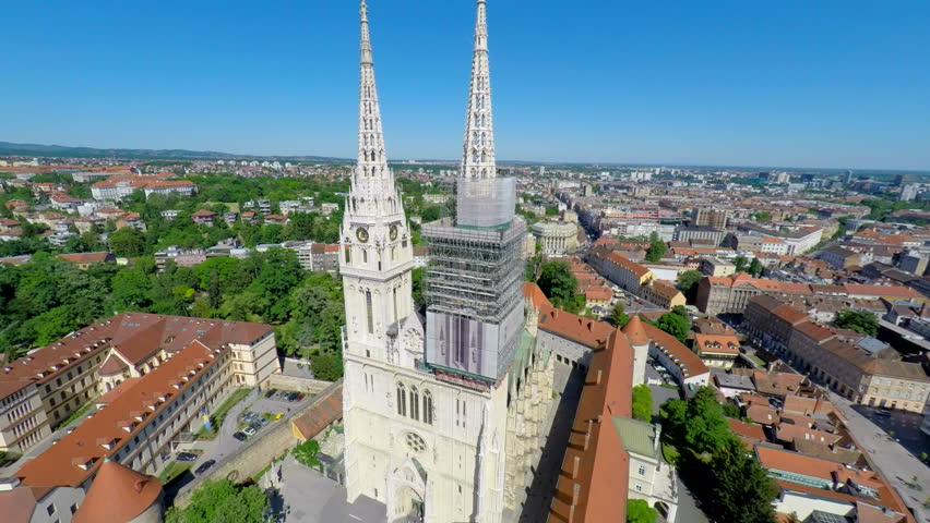 Aerial view of Zagreb's cathedral, with cityscape in background. | Shutterstock HD Video #11410442