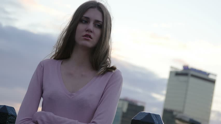 Upset depressed unhappy girl aimlessly standing alone. Middle shot. Slow motion. | Shutterstock HD Video #11414042