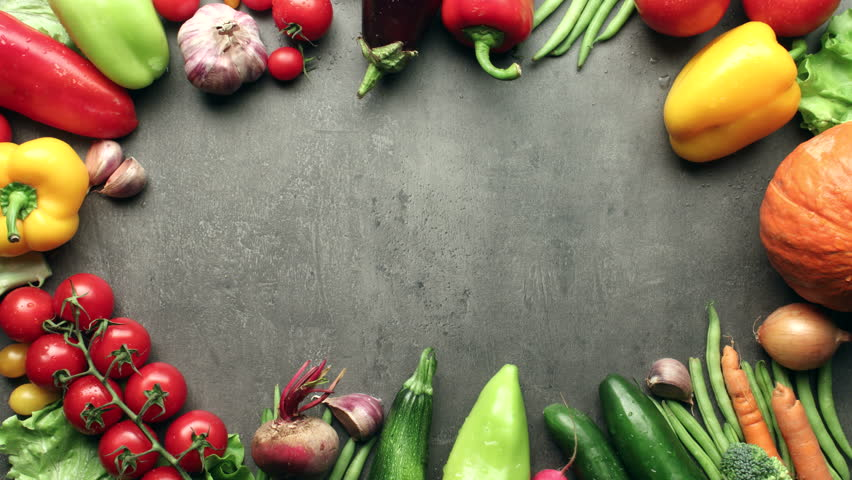 Fresh vegetables appearing on wooden table - stop motion animation