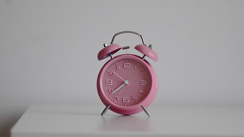 6e6fa0f38b1a48 Child comically trying to turn off pink retro alarm clock making ringing  sound