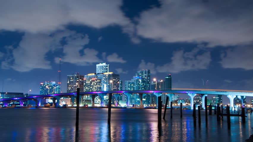 Time lapse of Miami skyline at night with clouds passing by - HD stock footage clip