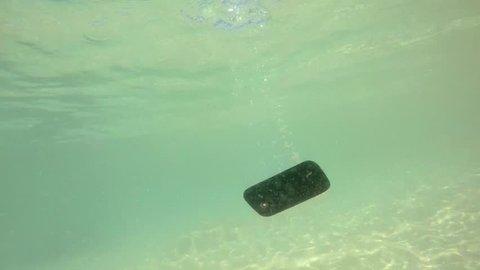 Smartphone Sinking in Sea Water. HD, 1920x1080.