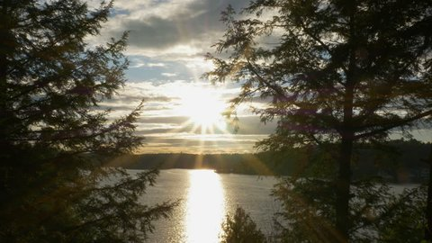 Late in the day. Sun going down over the lake. Lake Rosseau, Muskoka, Ontario, Canada.