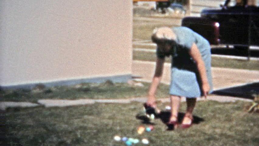 BOULDER, COLORADO 1951: Mom setting up Easter egg hunt for the children.