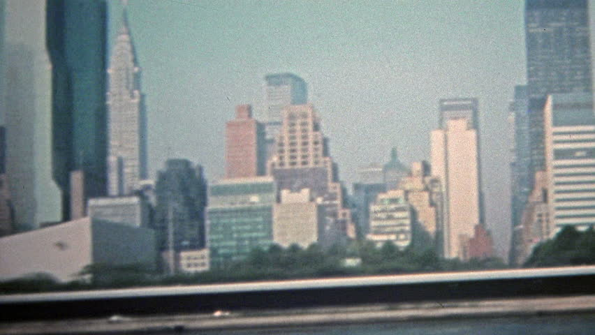 NEW YORK CITY 1975: Skyline of Manhattan high rise skyscrapers from the Hudson River.