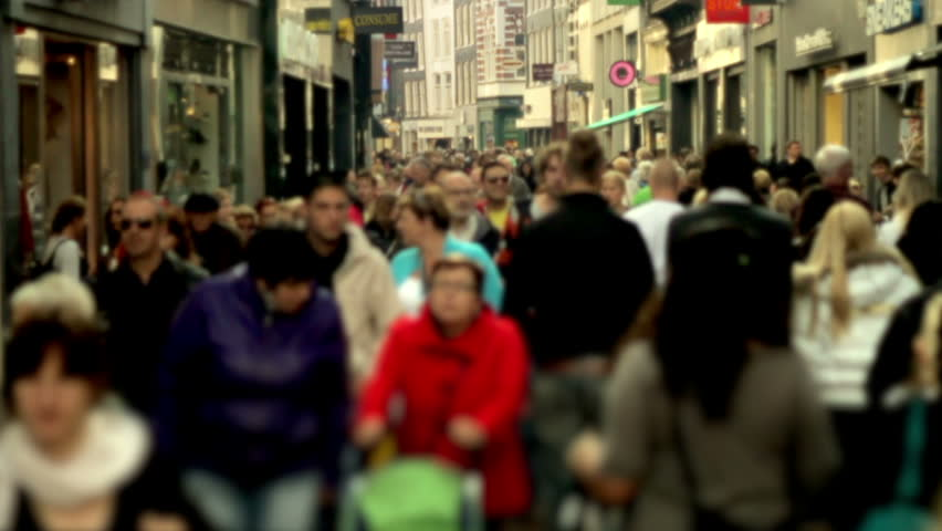 Slow motion crowd in shopping street blurred Shopping street filled with people. Filmed in slow motion. Faces are blurred and logo's have been digitally replaced.