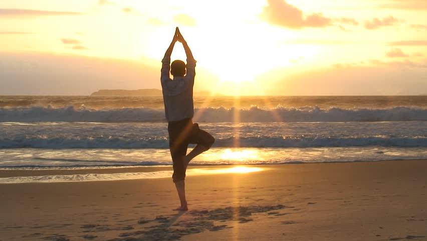 HD 1080i: Businessman man doing yoga on a beach at sunrise. #1153804