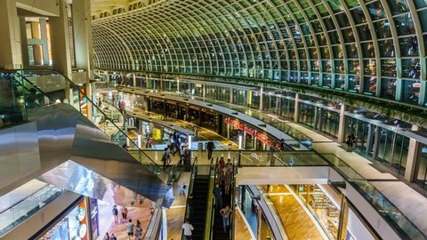 "SINGAPORE - August 31: Timelapse in motion - inside view in the shopping mall ""The Shoppe"" at Marina Bay Sands on August 31, 2015 in Singapore."