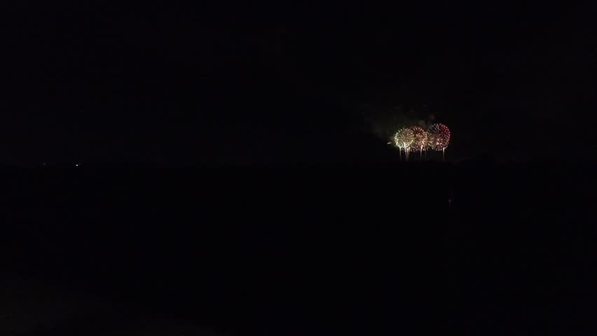 Distant view of fireworks _3 / September 5, 2015 in Japan of the shooting in Hokkaido / Shot with wide-angle lens the fireworks far away. As the background is black imaging material. . . | Shutterstock HD Video #11556416