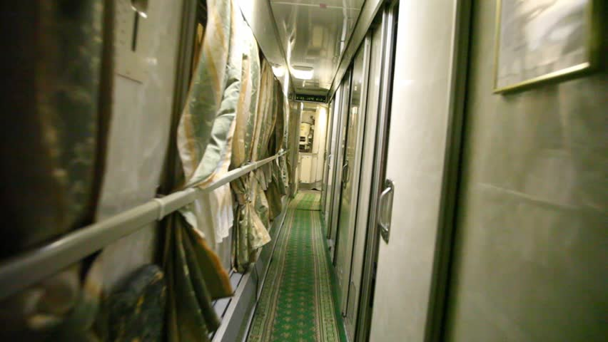 The person goes along the corridor of modern trains.