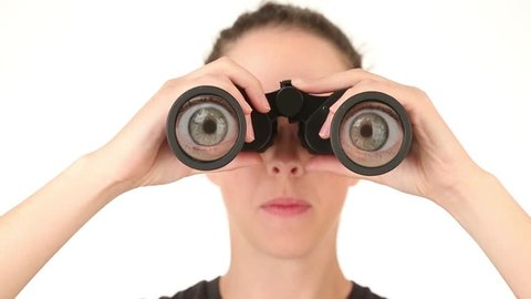 Young woman searching with binoculars, rolling eyes around.