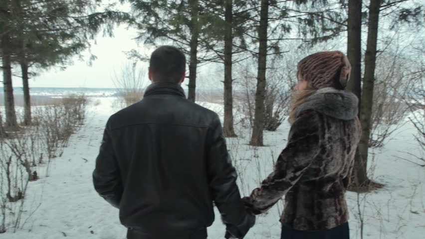 Young happy couple walking in winter park | Shutterstock HD Video #11577512